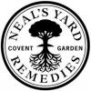 Rund svart cirkel med ett träd inuti och Neal´s Yard Remedies runt kanterna
