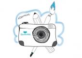 Bild på kamera, pensel och penna